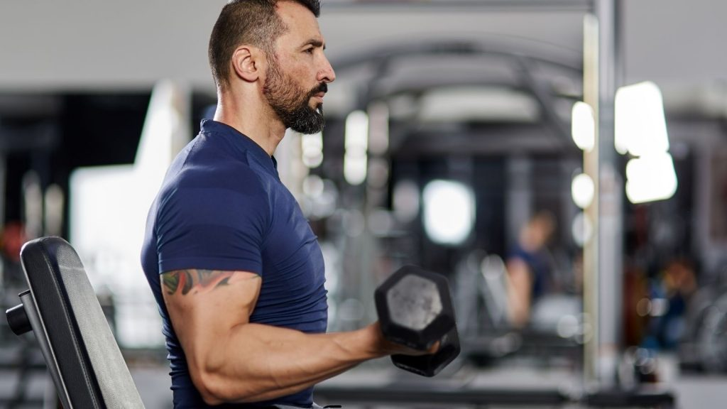 smaller biceps on guy working out