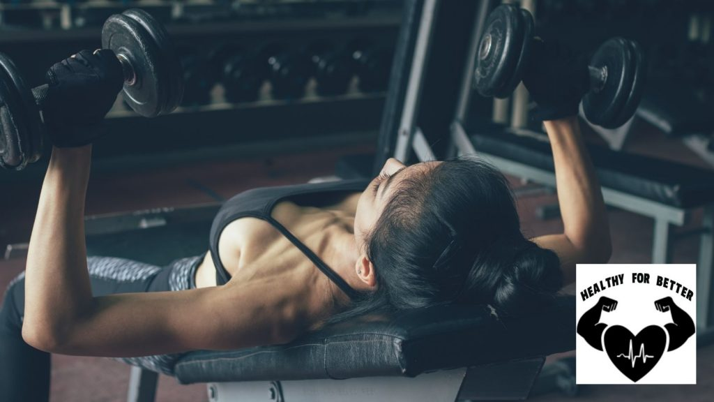 woman incline chest dumbbells