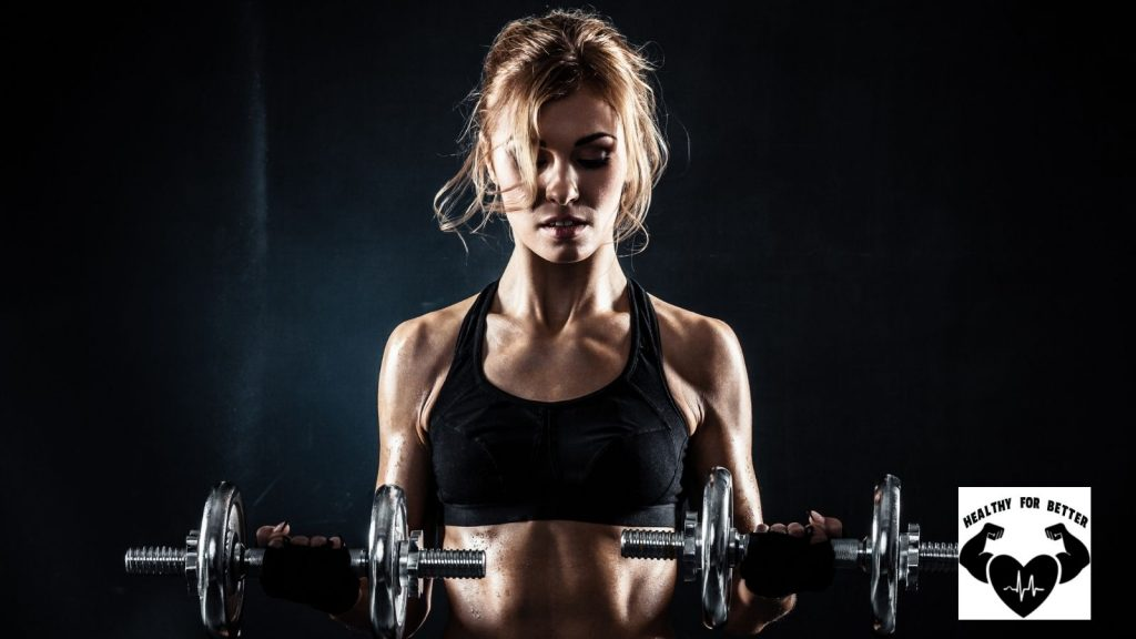 girl lifting two dumbbells
